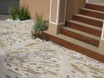 Revêtement de sol en pierre : galets plats et barettes de quartzite, paysagiste Saint Brévins