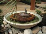 Fontaine avec bois pétrifié de Jérôme Besseau, paysagiste La Baule
